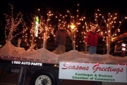 "The Chamber of Commerce took the ""parade of lights"" moniker seriously in their float interpretation."