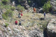 SAR teams send a Christina Lake woman's body to safety with the helicopter airlift; Photo, Mona Mattei