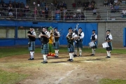Grand Forks Pipes and Drums lead the teams off the field at the conclusion of the ceremonies; Photo, Mona Mattei