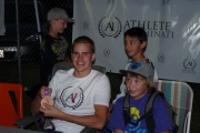Olympian Richard Weinberger has pictures snapped with local youth; Photo, Mona Mattei