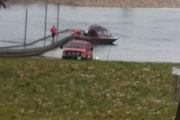 Car submerged in river; police welcome public input