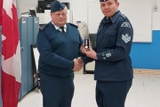 Squadron Commander Gerry Rempel presents Flight Sgt. Alec Pistak with medal.
