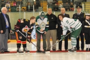 Nelson Mayor John Dooley conducts the ceremonial faceoff between Leaf captain Darnel St. Pierre (right) and Mark Walton of the Victoria Cougars. — Bruce Fuhr photo