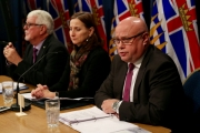 From left, Dr. Perry Kendall, Provincial Health Officer; Chief Coroner Lisa Lapointe; Clayton Pecknold, Director of Police Services release the latest information regarding illicit drug deaths in B.C. during a media conference Monday. — Photo courtesy BC Government
