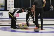 Geall third Andrew Bilesky encourages the front end of second Steve Kopf and lead Mark Olsen during the tenth end of the B-Final Friday afternoon at the Nelson Curling Club. — Bruce Fuhr, The Nelson Daily