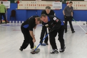 Lead Darren Will (right) and second Dave Toffolo try desperately to sweep a stone from skip Tom Buchy into the rings during Draw 2 action Wednesday at the Nelson Curling Club. — Bruce Fuhr, The Nelson Daily