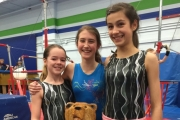 Glacier gymnasts, from left, Chloe Diotte, Kate May and Raven Sperling were all smiles after returning from the Great West Gym Fest in Coeur d'Alene, Idaho. — photo courtesy Glacier Gymnastics Club