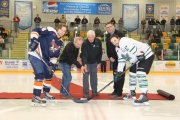 Taylor Stafford of Beaver Valley and Nelson captain Aaron Dunlap wait as Denis Kleine (left), Bill McDonnell and Leaf president Larry Martel perform the ceremonial puck drop to start Monday's KIJHL playoff game at the NDCC Arena. — Bruce Fuhr photo