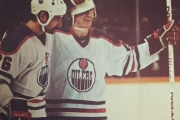 Pat Price, seen here giving teammate Wayne Gretzky a congratulating tap on the helmet, is off to the BC Hockey Hall.