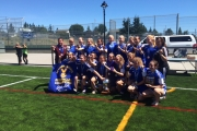Smiling from ear to ear with the Provincial High School banner, the LVR Bombers pose for the team picture following a victory in the BC High School AA Girl's Soccer Final. — Photo courtesy Abby Bouchier-Willans