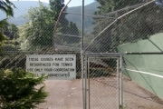 Tennis anyone? Not today after trees knocked down the west wall of the courts. - Bruce Fuhr photos, The Nelson Daily