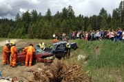 Mount Sentinel High school students watch as emergency crews deal with mock two-car accident Friday near the South Slocan based school. — photo courtesy Mount Sentinel High School