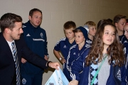 Whitecaps Kootenay Regional Coach Brett Adams watches as Caps' defender Jordan Harvey signs autographs for players during a recent Kootenay trip to watch an MLS game in Vancouver. — Submitted photo