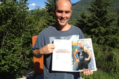 Steve Archdekin shows off his photo and story in the summer issue of Triathlon Plus. — Bruce Fuhr photo