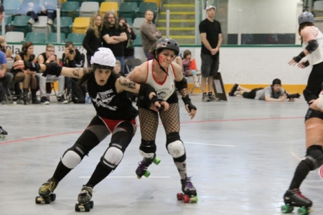 Terminal City jammer Kim Janna sneaks past this Kannibelles blocker during action in the final of the Klash of the Kootenays Sunday at the NDCC Arena. — Bruce Fuhr photo